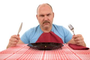 1849006 - mature man looking very angry with the content of his plate