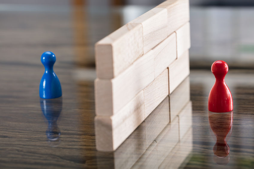 Red And Blue Figurine Paw Separated By Wooden Blocks
